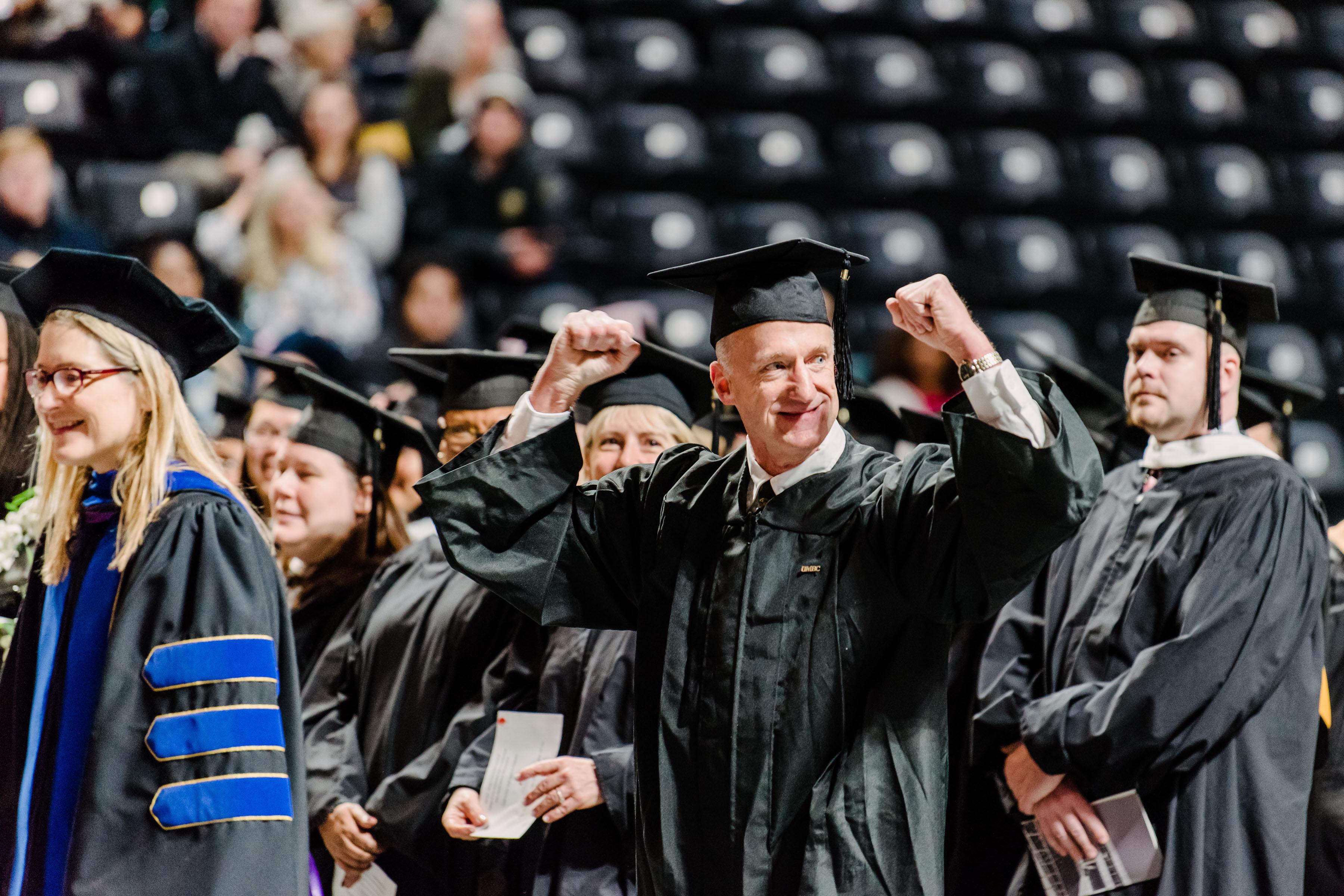 UMBC faculty member celebrates at Graduate Commencement.
