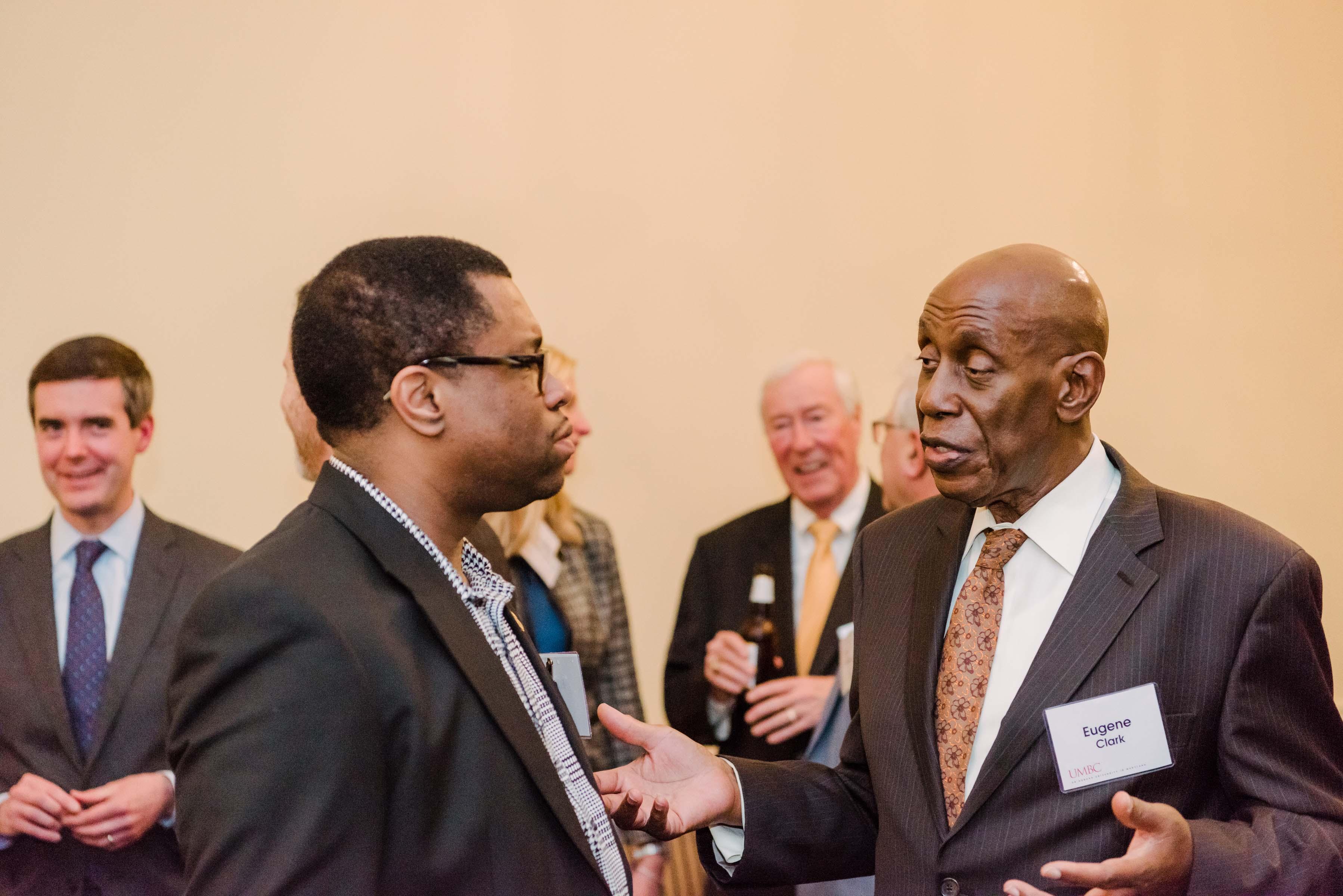 two men talking at Annapolis alumni reception