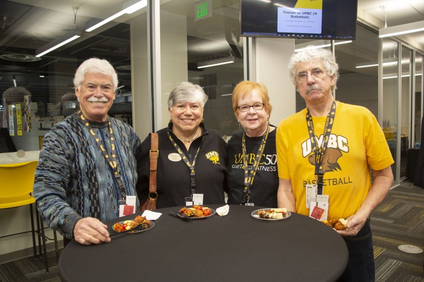 Mimi Dietrich '70 (third from left) enjoys cheering on the Retrievers in her black and gold. Photo courtesy of Josh Sinn '13.