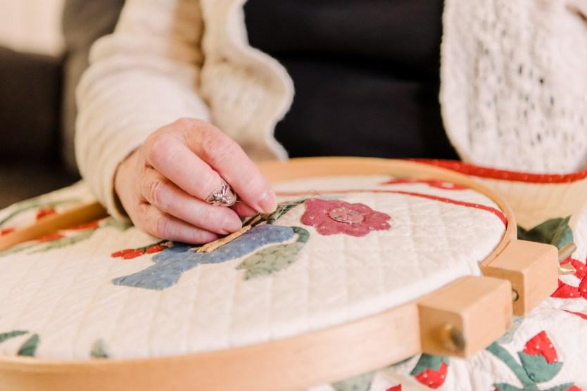 Mimi Dietrich '70 sewing