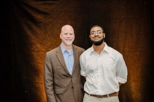Two guys pose together at scholarship luncheon
