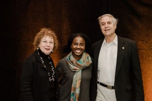 Ana poses smiling between couple at scholarship luncheon