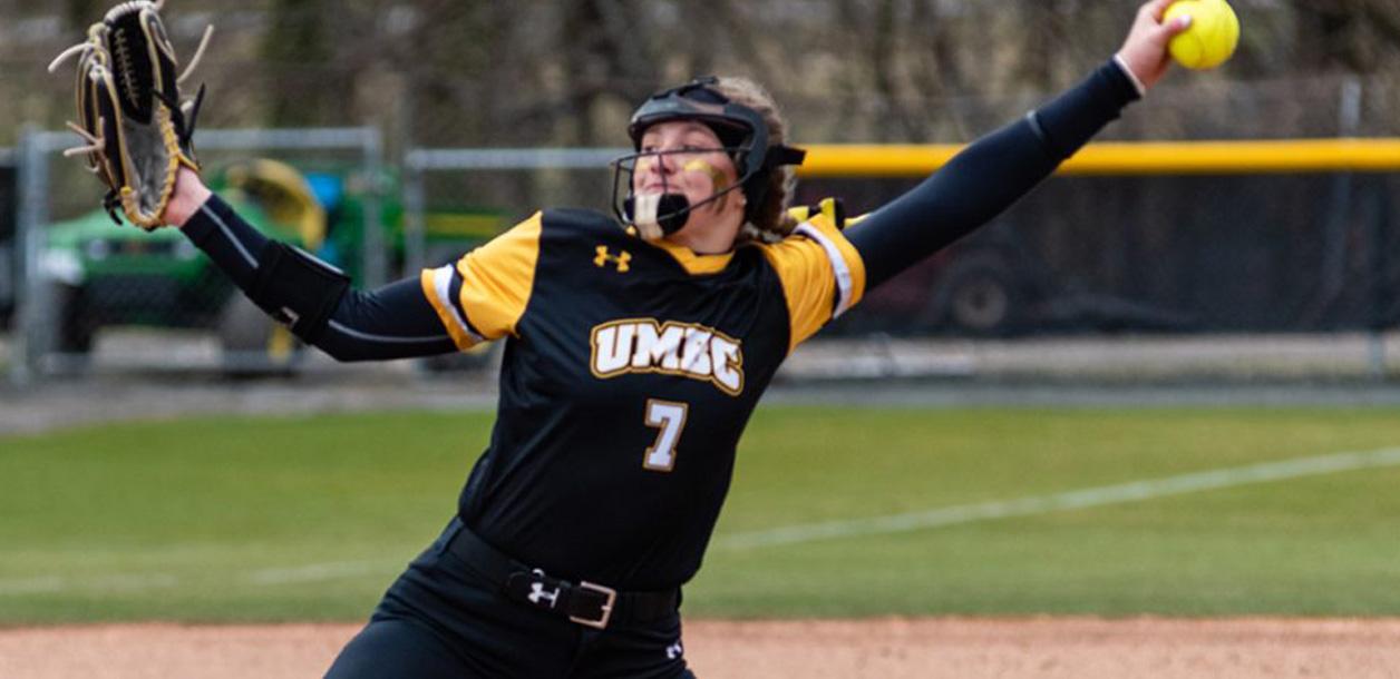 UMBC Softball player holds softball