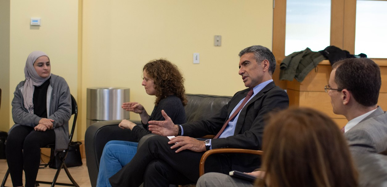 Paul Raphael '83 speaks to a group of international students. Photo courtesy of Raquel Hamner '20.