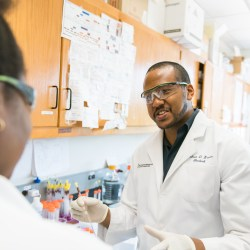 Joshua Brown, an IMSD Meyerhoff Graduate Fellows, worked in the lab at UMBC. Photo courtesy of Marlayna Demond '11.