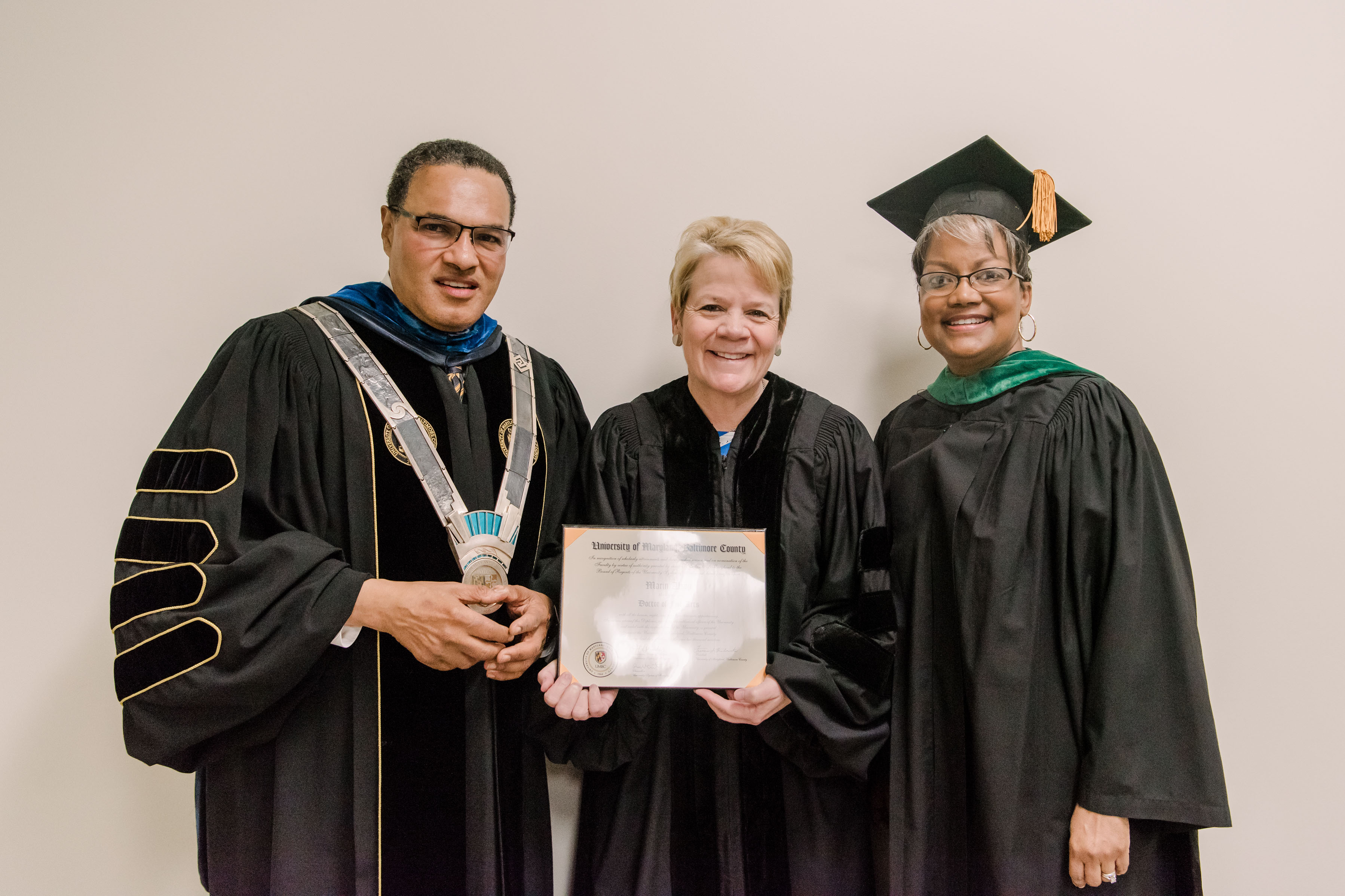 Hrabowski poses with two others in graduation regalia