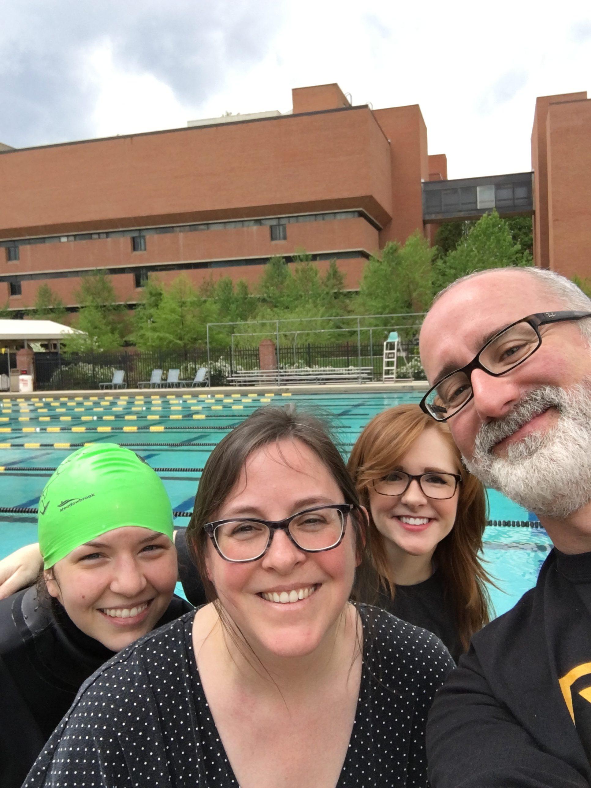 staff takes selfie by pool