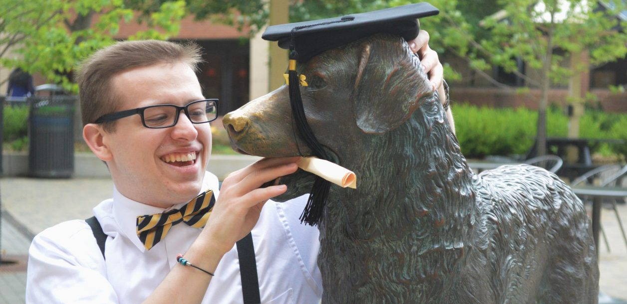 Zack Smedley '18 goofs around with True Grit. Photo courtesy of the author.