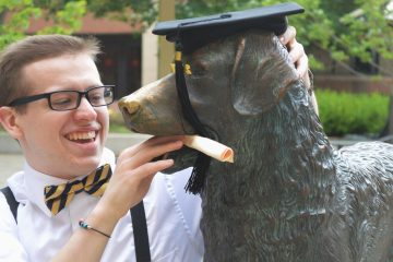 Zack Smedley '18 goofs around with True Grit. Photo courtesy of the author.