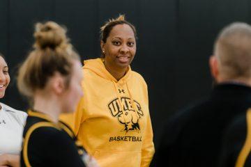 women's basketball coach smiling