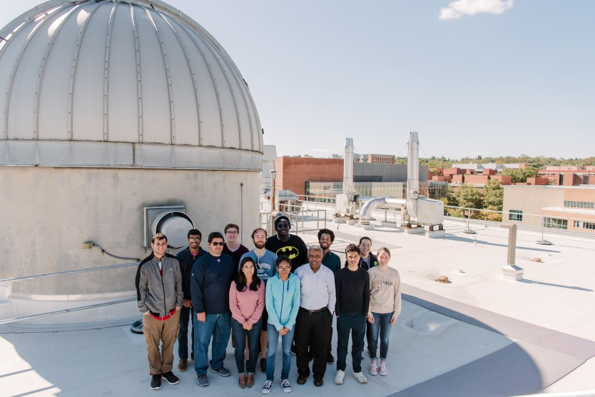 Demoz with a group of his students on top of the physics building. Photo by Marlayna Demond 11.