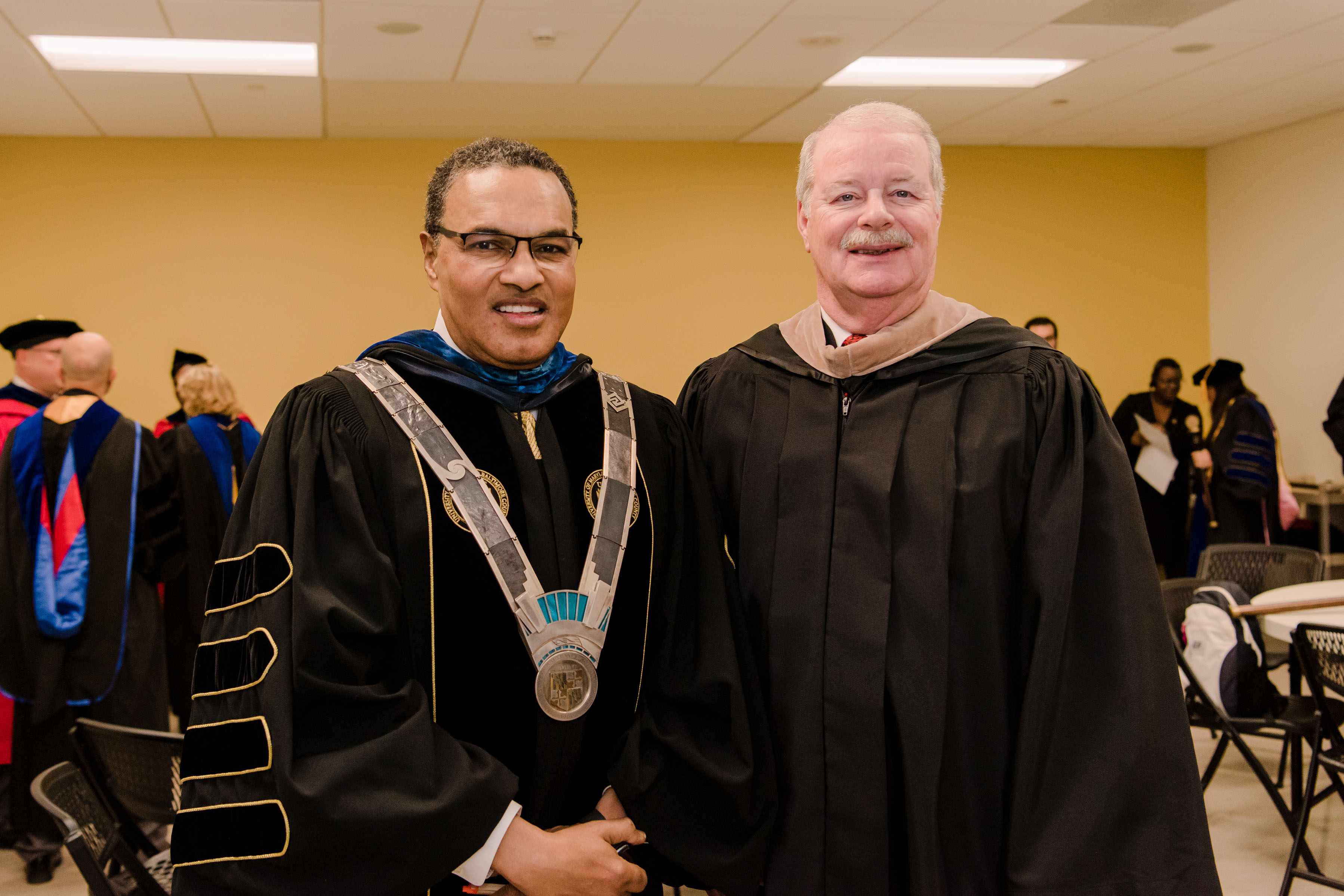 President Hrabowski poses with man in graduation robes