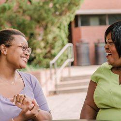 Alicia Wilson laughs with UMBC student Sydney Fryer