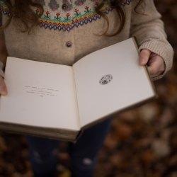 girl in sweater reading