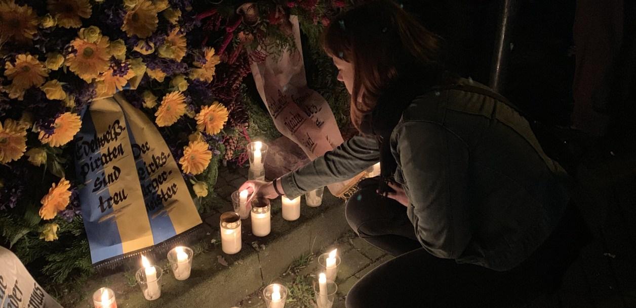 Kristina Gaddy lights candles at a memorial