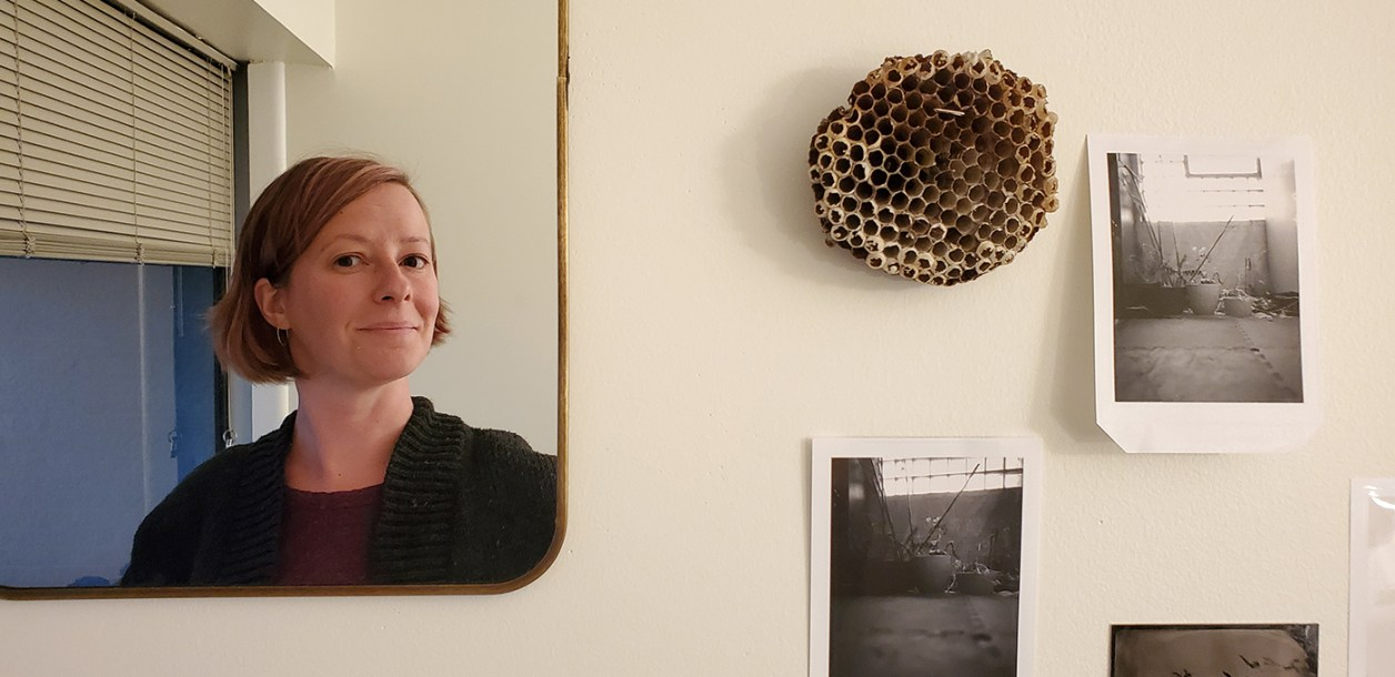 Melissa Penley Cormier in a mirror next to one her paper wasp nests and other photos