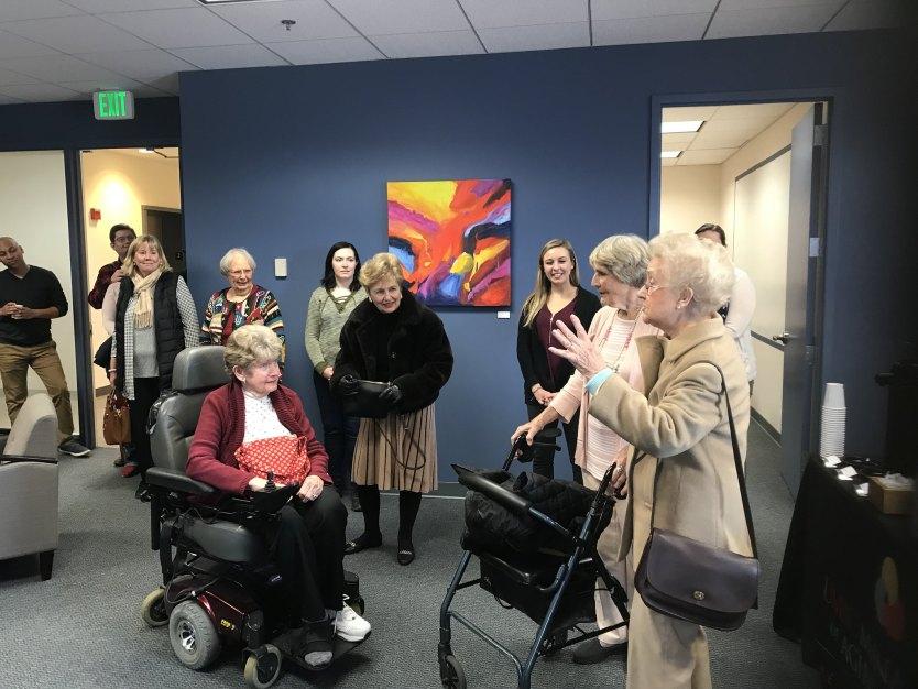 Senior citizens talk about their art exhibit