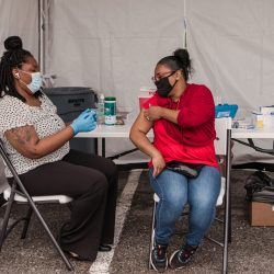 Woman recieving Covid-19 Vaccine