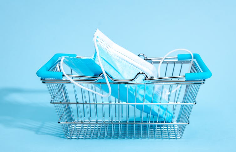 Photo of shopping basket with a health mask inside