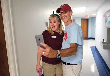 The president snaps a selfie with resident adviser Lindsey Crawford '18 on move-in day.