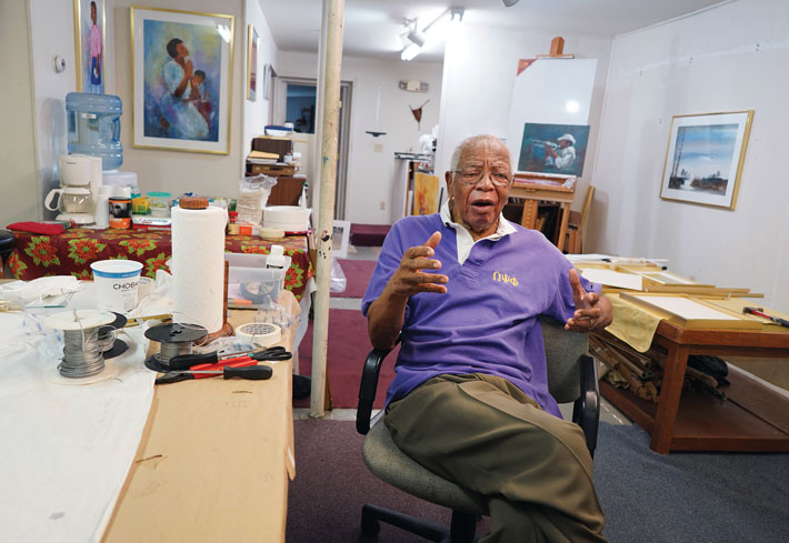 Johnson paints regularly in his studio on Charles Street in Fredericksburg, above. His paintings hang in embassies, banks, hospitals, and homes as far-flung as Europe and Africa. His work has taken him to Jamaica and the African nation of Benin as the guest of longtime friend and U.S. Ambassador Pamela Bridgewater, herself a collector of Johnson's art. (Photo by Suzanne Carr Rossi '00)