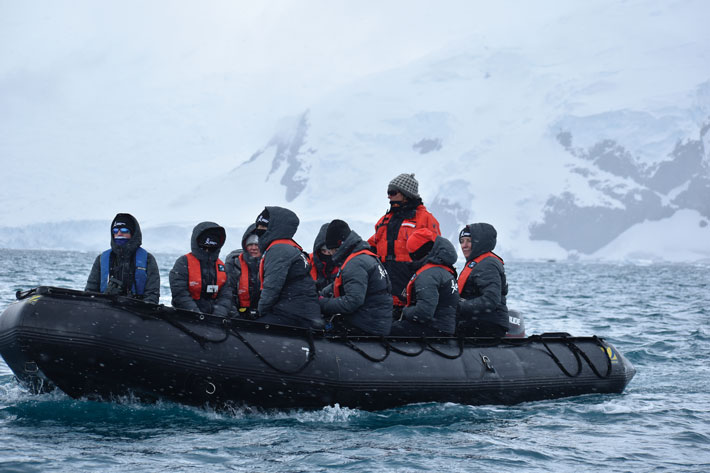 Scientists embark in a Zodiac craft to make an Antarctic landing. Photo: Christina Devorshak '91