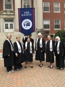 Members of the 1908 Society and a flag-bearing student participated in commencement. Pictured (from left) are Catherine May Findley '65, Madeline Lankford Withers '59, Irene Piscopo Rodgers '59, Michael Gilchrist '20, Kay Rowe Hayes '59, Ann Strickler Doumas '55, and Carolyn Eldred '66.