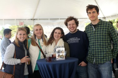 Alums met up under the tent for a refreshing beverage during homecoming.