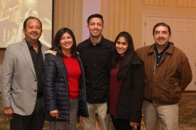 Andrew Sical '16, center, celebrated with his family at the December graduate reception hosted by the Alumni Association.