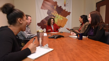 Crislip, center, collaborates with HOME colleagues, from left, Brianna Pitchford, Mike Burnette, Brenda Hicks, and Bethany Evans. (Photo by Clement Britt)