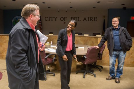 Bel Aire city attorney Jaci Kelly, center, shares a light moment with Mayor David Austin, left, and City Council Member Jeff Hawes after a council meeting in February. Fernando Salazar photo