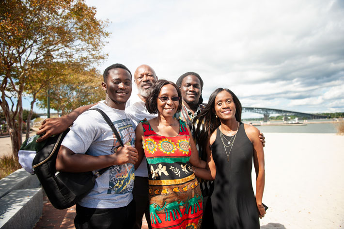 Jaci Kelly, far right, visited her family in Virginia last September. From left, they are her brother Sam McClain, father Ricky McCain, mother Yvonne McClain, and brother Khosi McClain. Stephanie Kalis photo