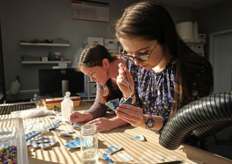Artifacts found in a dig come back to the Dovetail offices for study, cleaning, and preservation. Here, lab manager Kerry S. González, left, and Reagan Andersen '18 work on shards of pottery found in Fredericksburg.