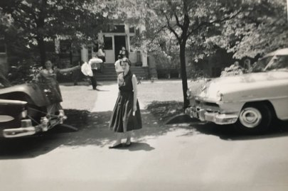 Mary Fredman Downing arrives at Willard Hall on her first day at Mary Washington College in 1955, her car trunk tied to hold her belongings. Her father, Fred, took the photo, and younger sister Ann is pictured.