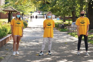 Eagles Care Ambassadors including (from left) Anna Longacher, Katherine Brady, and Abby Zimmerman reminded fellow students to stay distanced, limit group sizes, and wear face coverings. [Suzanne Carr Rossi '00]