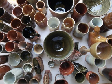 Finished pottery demonstrates a variety of forms and glazes.
