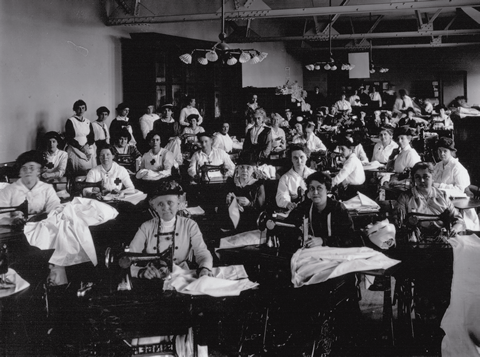 """Sewing for solidarity"" - Women sew for the war effort in the old University of Toronto library, Canada"