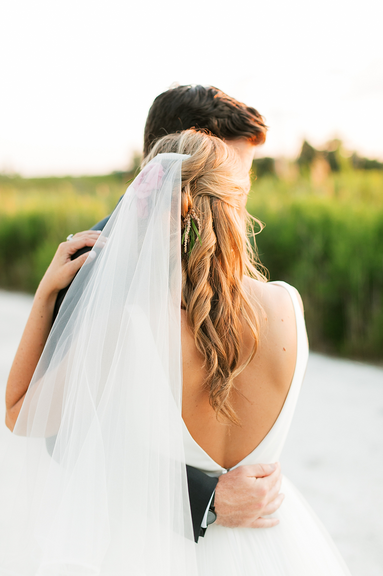 just married portraits at sunset