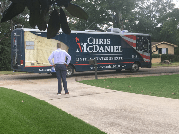 Zach Holbrook in front of Chris McDaniel RV