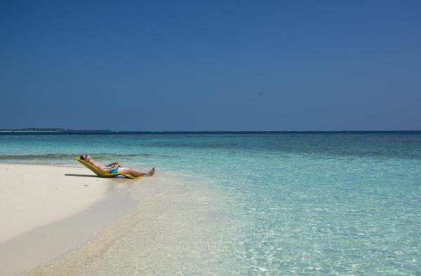 Белите плажове, тюркоазено синята вода на плажовете на Малдивите