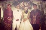 Right to left: Magelang's Mayor Sigit Widyonindito, Nurul, Domas and Mayor's wife Yetti Biakti Widyonindito in the wedding reception at Domas's home in Kampung Menowo.