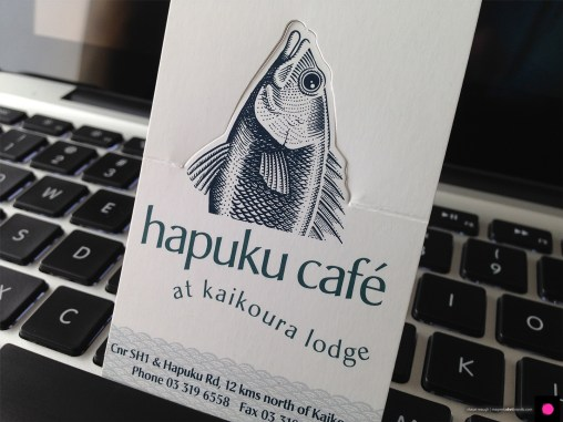 Novel pop-up Hapuku Cafe and Lodge logo business card, a business card and a calling card rolled into one. Digital illustration, logo design and graphic design, Christchurch, New Zealand.