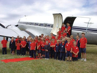 Group photo of children with the Southern DC3