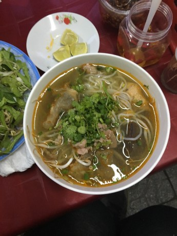 Bun bo Hue mixed with other toppings