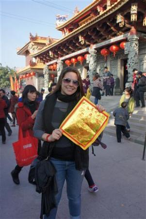 XIAMEN- doing the symbolic New Year tradition, of burning the prayer paper