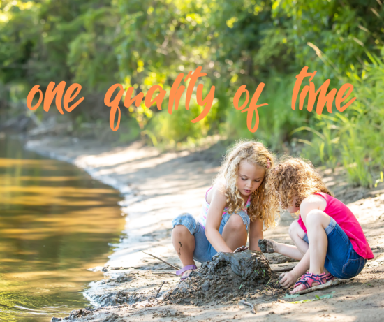 two young girls playing in the mud