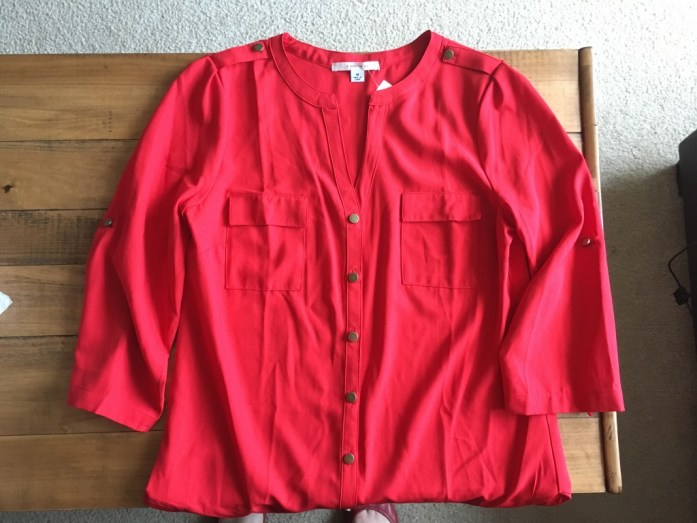 Red roll-sleeve v-blouse
