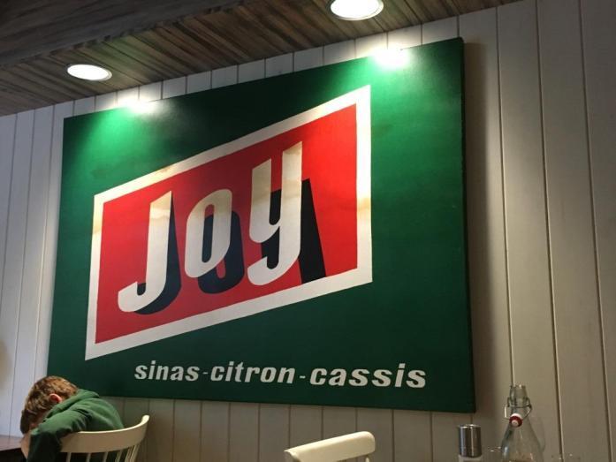 Hanks Pasta Bar Joy Room sign