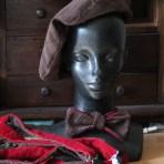 Pinwale corduroy reversible beret, bow tie, and suspenders.
