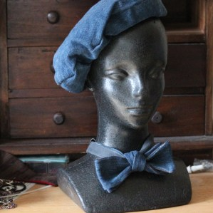 Blue jeans side of reversible beret and bow tie.